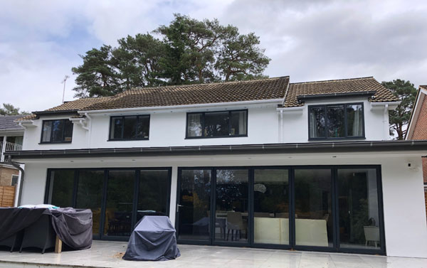 Rear of the extension with an elevated porcelain tiled patio.